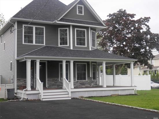 Totally redone turn of the century Colonial in Heart of Wantagh Woods , Classic Charm meets Energy Efficiency ! New Custom EIK , 2.5 Baths , Roof , Flooring , Electric , LED Lighting, Plumbing , Hvac , Hot Water Heater, Windows, Doors , IGS , Wrap around Porch , 2nd floor Laundry,  TOO MUCH TOO LIST !!! MID Block Quiet and private location !