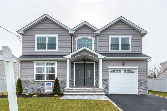 Exciting Brand New Colonial ready for occupancy soon! 4 Bdrm, 2.5 Bth Colonial With Two Story Entry Foyer, Formal Living And Dining rms,  Centre Isl. Eat In Kitchen, Den With Frplce. 2nd Floor Master Bdrm. W/ En Suite Bath And Walk In Closet, 3 more Bdrms W/ Bth. 2nd Floor Lndry And Large Walk Out Basement. One Car Garage. End of Summer Occupancy. Close To All Transportation, Shopping. Plainview /Old Bethpage Schools! This Home Has All The Bells And Whistles.