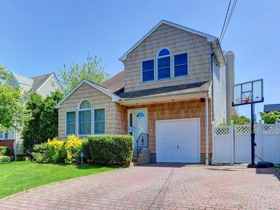 Excellent condition young house built in 1991. Central Air, 2 zone heating. 4 bedrooms, finished basement. Herricks school, cross street from park, quite street yet close to shopping, LIE and highways.Must See.