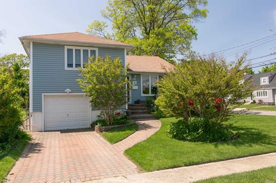 Beautiful Split Level Home On Oversized Lot In Massapequa Park. Updated Kitchen Has Quartz Counters, Stainless Appliances And Access To A Spacious Deck. This Home Is Complimented By Gleaming Hardwood Floors Throughout. Oversized Den Allows Access To Rear Pavered Patio And Lush Green Entertainers Backyard. Top This All Off With A Finished Basement With Laundry Room. Come See This Great House In A Great Neighborhood!