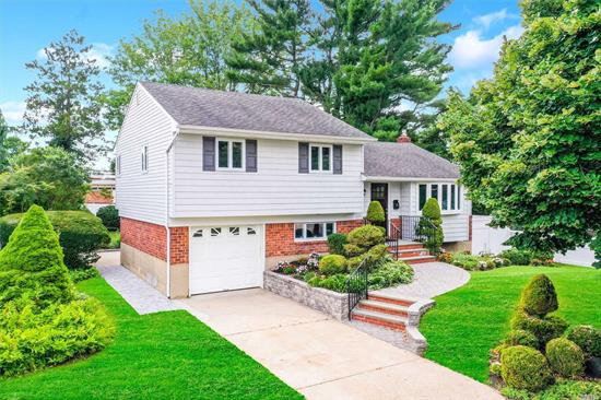 Beautiful Renovated Split with High End Stainless Steel Appliances, Vaulted Ceiling, Huge Center Island, Open Concept Layout, Hardwood Floors, Stacked Stone Electric Fireplace, New CAC, New Boiler, Outside Entrance, Huge Patio, Large Backyard