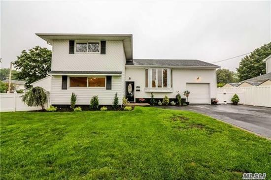 Diamond 4 level split .totally renovated , Large, EIK , Formal dining rm. French doors to multi level deck All S.S. appliances, H.W Floors, porcelain floors, forced hot air, Gas heat, , CAC , IGS, 200 Amp Electric, 4 bedrooms, 2 1/2 baths , laundry Rm.