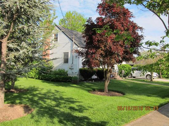 Huge Corner Property. This lovely 3 bedroom Home has it all. The front yard is your own Botanical Garden. The backyard is large and has a Patio for your summer barbecues. Inside there are 3 lovely Bedrooms and 2 Full Bathes. Cook your meals in the large Chefs Kitchen with plenty of room to have Breakfast with the family. The Dining Rm has a delightful Fireplace and the Living Rm is cozy and comfortable.The Basement has a Family Rm as well as a space for an Office or Den. Close to All