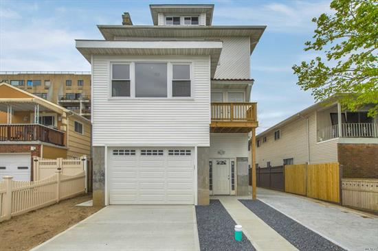 Welcome to this completely renovated and raised Two Family Home In The Heart Of Long Beach! Conveniently located To LIRR And Beach, this home offers two units hosting 3 bedrooms, a full bath, living room and kitchen each. Their is a cozy backyard, an attached one car garage and a detached two car garage. A must see.