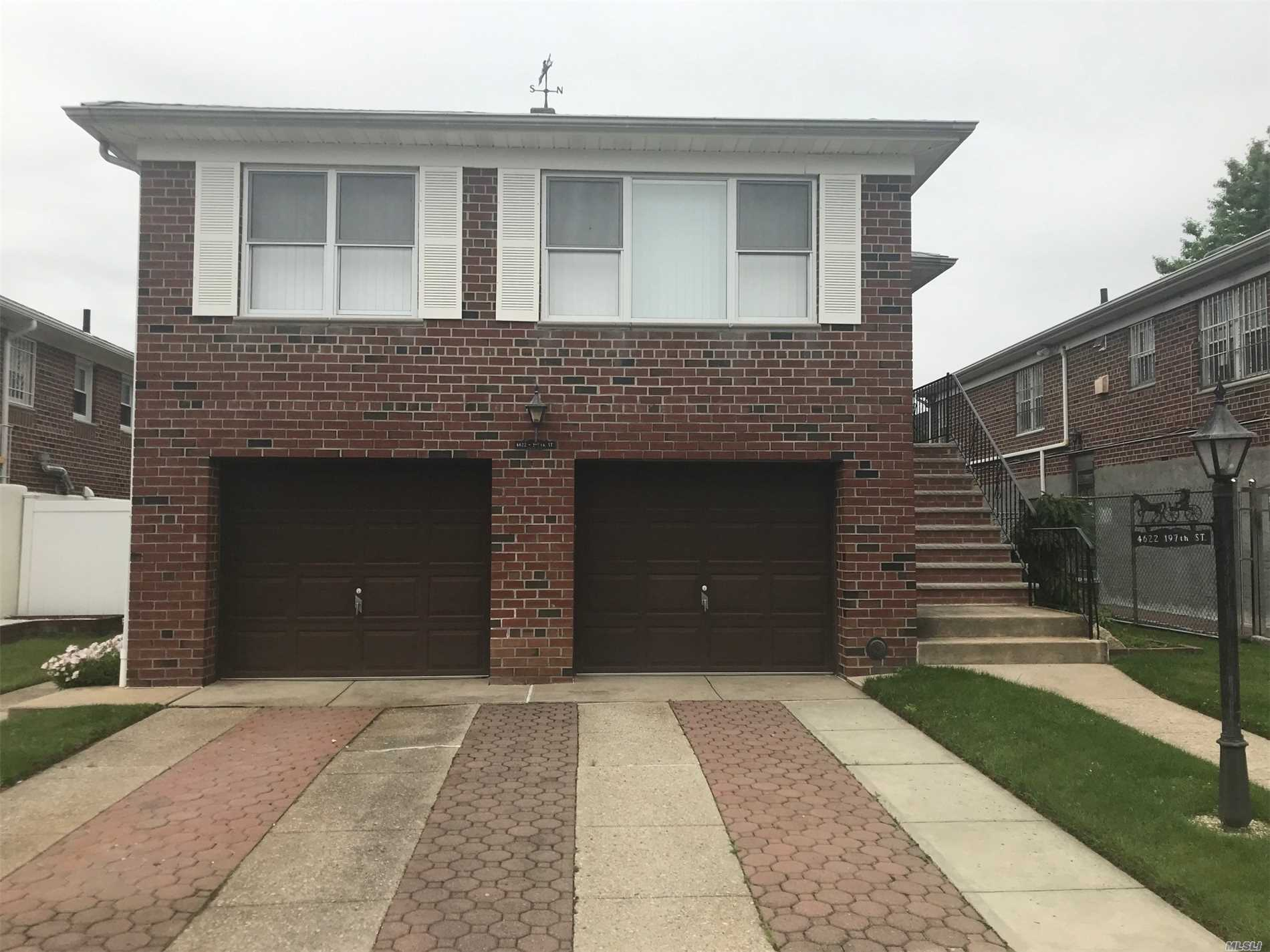 Fab brick 2 family spotless and sun-drenched home in quiet neighborhood. 1 BR apartment on 1st floor, 3 BR apartment on 2nd floor. Deep private yard with patio. 2 car attached garage. Updated Kitchen and Bath. This is a must see