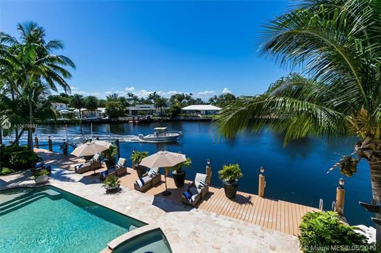 This Tropical Lushly Landscaped Paradise In Coral Ridge Is An Executive'S Retreat. Spanning Over 4400 Sf, This Magnificent Waterfront Residence Is Graced By Soaring Ceilings And Wall To Wall Windows With Wide Water Views. The Grand Entryway Will Draw You Into An Open Floor Plan Layout Made For Entertaining. The Elegant Layout Includes Formal Living Room, Brand New Chef'S Kitchen, Breakfast Room, Bar And Family Room. Relax By Your Covered Outdoor Dining Or Grill Bar, Then Sip Ice Tea By The Pool. The Dock Boasts 112 Feet With A Boat Lift Perfect For Your Water Toy. Close To Mall, Restaurants, Beach. Bayview School District.