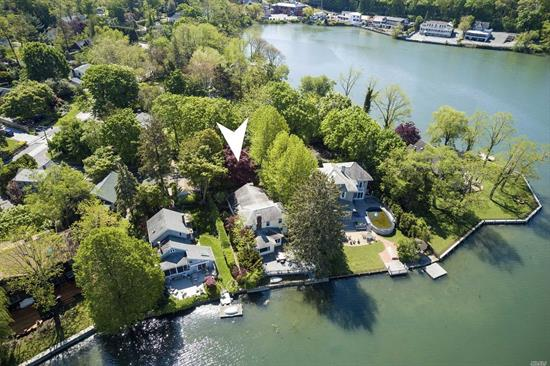 Waterfront Mill Pond Home with Panoramic 180 degree Waterviews.New 2018 30ft Sea Wall/Bulkhead w/Direct Access to Water & Fishing.Separate Docking Rights for Navigable Waters at Centerport Harbor.Wrap Around Trex Deck in Natural Shade.Cottage Entry leads to Wood Beamed Living Room w/ Wood Burn F/place & flows to Nautical Style Family Room & Deck.Gas Cook Eat in KItchen w/adjoining Dining Area.1st Floor Great Room could be Master Bed, Den, Office.Rare chance to own true Waterfront Living w/Low Tax.