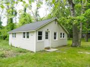 Newly renovated. Unfurnished. Cottage. 2 bedrooms. Full bathroom. Living area. Washer & Dryer. Parking. Year round rental.