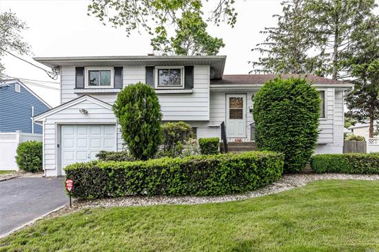 Lovely 3 Bedroom Split In South Bellmore For $449, 000. A Great Midblock Location Situated On A 62X100 Lot, Close To Newbridge Park & Across The Street From Shore Road School. A Great Home W/ High Basement Ceilings, Multiple Living Spaces, and Opportunity To Make Your Own.