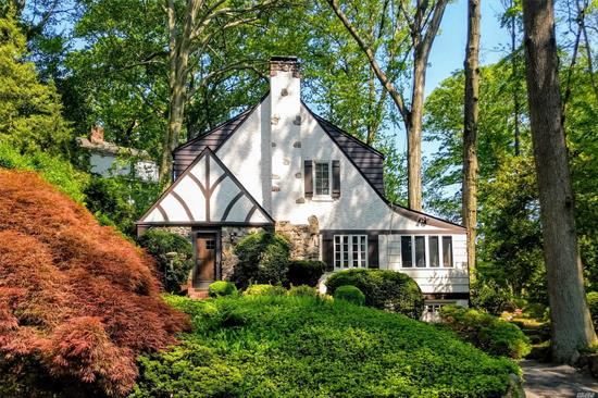 Tucked at the end of a quiet street, close to town, train and Pine St Park, this home has the charm of an English Cotswold Cottage. Inviting interiors w hand-hewn woodwork & ironwork. Entry foyer opens to beautiful oversized living room accented by built-ins and stone fireplace. Generous formal dining room, sun-filled orangery style den, master, 2 bedrooms, large updated bath. Turnkey home w new system and appliances. Beach Rights w dues. Taxes grieved w 11.33% reduction for 2020/21.