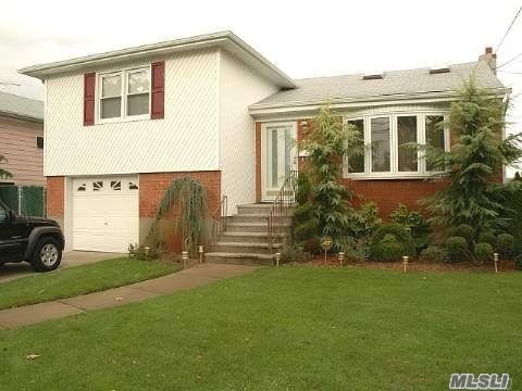 beautiful 3 bedroom 3 bath split large finished basement open space large garage with additional sub basement very large home walk to lirr
