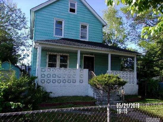 3 Bedroom 2 bath colonial close to all. Large yard. Needs TLC