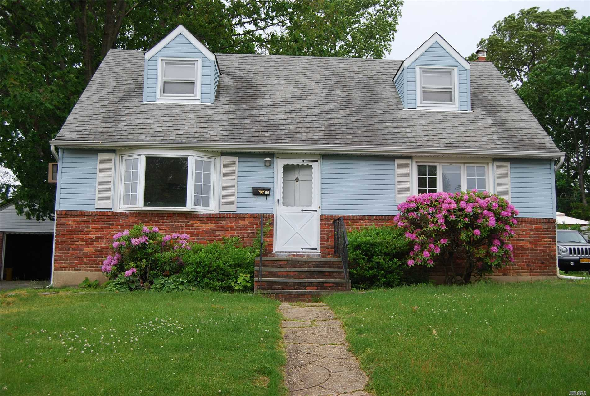 An Expanded Cape with 4 Bedrooms, 2 baths, Kitchen, Living Room, Dining Room, wood Floors, full basement, 1 car garage and private backyard.