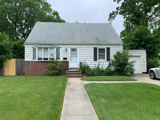 4 bedroom, 2 full bath cape with 6 year old roof and oil tank, full basement, partially finished part set up as a work shop, nice flat yard, priced to SELL