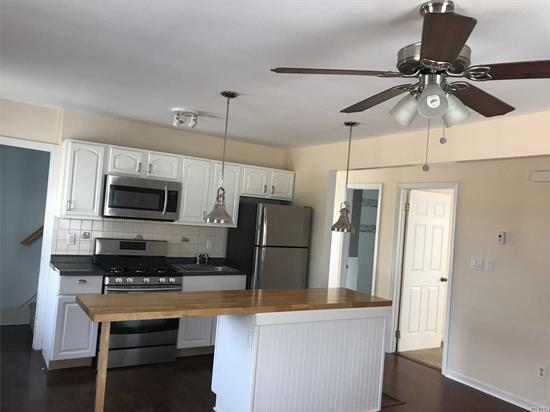Renovated Updated 2nd and 3rd Floor Unit with a New Kitchen, Bathroom, Hardwood Floors, Open floor Plan, Use of 1/2 Garage and Yard. 1 Car Parking in Driveway and a Municipal Lot 3 Houses away. Close to Lirr and Shopping
