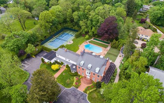 The Charm Of A By-Gone Era Co-Exists with Today''s Modern Ammenities in this Stately 17 room Mansion with Pool, Tennis, Pool House, .The Grand Salon, Library and Formal Dining with Beautiful Marble Fireplace Mantles are Still Evident Of It's Lavish History. 11 Bedrooms include 2 Master Suites with 9 Renovated baths. A Gracious Wrap Around Porch Overlooks The Resort Style Backyard. Separate Guest Cottage, 3 Car Garage, Roslyn SD#2