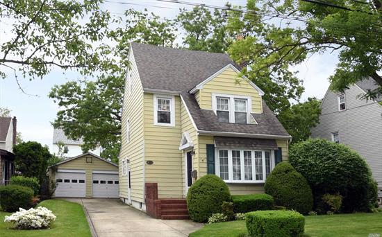 Very Hard To Find 60x100 Property With A 2 Car Garage Are Just Some Of The Amazing Things This Classic Colonial Has To Offer. Charm Galore With An Updated E.I.K., Large Living Room With Wood Burning Fireplace, Formal Dining Room and Inviting Sunroom. There Are Beautiful Hardwood Floors, Finished Attic And Basement! First Open House Don't Miss Out!!