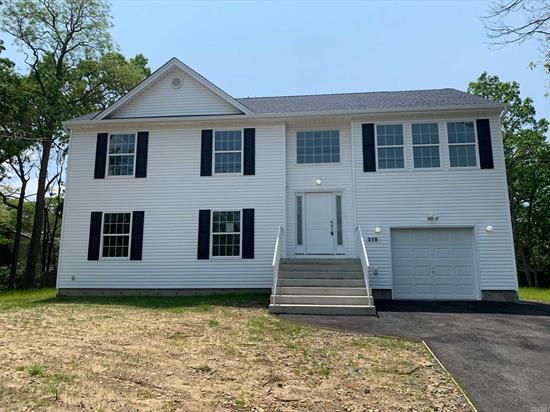 Brand new Hi Ranch to be built. 5 bedrooms, 3 baths PLUS full basement with outside entrance and garage. Standard features will include: central air, hardwood floors, granite kitchen. Beautiful treed lot in the heart of Center Moriches. Taxes TBD.
