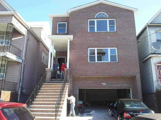 Brand new construction. Gorgeous 2 family house, oversized lot. Central A/C, hardwood floors throughout, granite counter tops, SS appliances. Full, finished walkout ground floor. Located in Midtown Bayonne on nice and quiet block. Near shopping, school, and transportation.