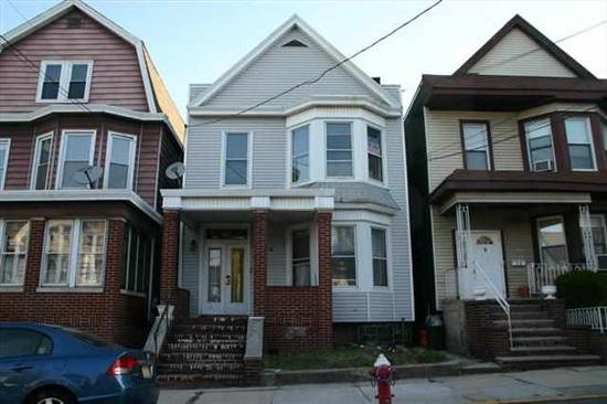 2 Family close to schools and parks, a short walk to Blvd East and NYC transportation, and short 5 minute walk to light rail and Ferry to NYC. Bright rooms with lots of windows, unfinished basement, nice yard, separate boilers for each apt. Boilers and water heaters only 2 years old. Tenant on a month to month lease.
