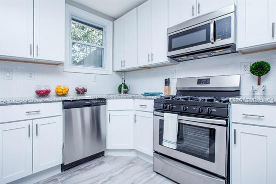 Beautiful renovated two family home. Each unit featuring 3Bed/1Bath. Beautiful modern eat-in kitchen w/white shaker cabinets, quartz counters & SS appliances. Featuring hardwood floors and plenty of natural light flow throughout the home. private backyard with patio for your summer BBQs! Hugh finished basement w/ washer and dryer hookups. Close to transportation to NYC & shopping.  ***8 blocks from light rail ***
