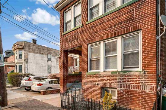 Gorgeous all brick 2 family house in most desirable location in North Bergen. Unit 1 features two bedrooms & one full bath with a large formal dining area, living room, and closed porch. Unit 2 has similar layout but with additional bedroom and renovated kitchen. The house features several major renovations that include cement removal of whole perimeter floor that increased the height in basement and reinforced with industrial beams. Basement also includes plumbing for bathroom and kitchenette. Additional upgrades include new gas heating units for each floor, new water heater for Unit 2, all new windows, repaved & reinforced walkway and complete separation of utilities for both floors (including separate water and sewage lines). Handicap parking available at the front of the house. Also located just 3 blocks from JFK Boulevard East with buses to NYC and close to schools & James J. Braddock Park.