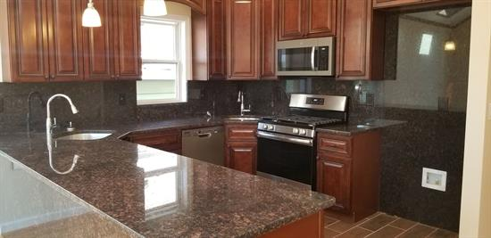 Come see this quality built 2 family new construction in a booming Jersey City market. House features: Hardwood flooring, Central air/heat, total of 6 bedrooms and 4.5 bathrooms, garage parking. Laundry room for each apartment. Kitchen features, granite counter, cherry oak cabinets and plenty of counter space. Live in one unit and rent the other. BONUS-Property will have 5 year tax abatement!!