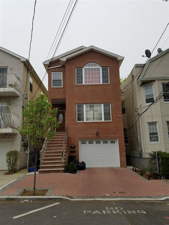 This beautiful 2 family house is a delight. House offers plenty of natural sun light and plenty of space. Second floor offers 3 bedroom and 2 bath washer and dryer room, hardwood floors, central air/heat, granite counters and cherry oak cabinets. First floor has the same features except is duplexed with 2.5 baths and a very spacious recreation room. This is a must see.