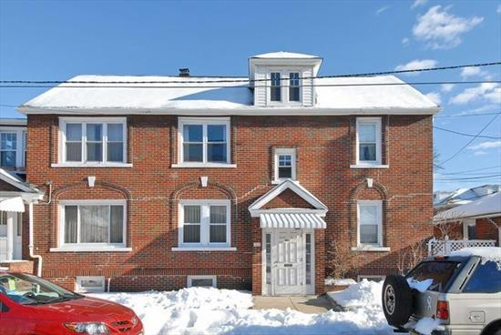 Racetrack location in Upper North Bergen, two very large apartments each with 3 bedrooms, living room, dining room and sun porch, separate heating units, and two car garage, very large basement and walk up attic.