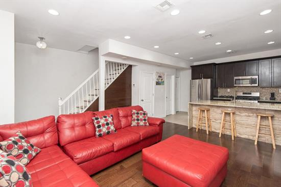 Don't miss this amazing tri-level one-family unit in the bustling Jersey City Heights! This 2BR+Den/2.5BA home is wonderfully updated. The kitchen boasts beautiful espresso wood cabinets, tile backsplash, stainless steel appliances and a standout countertop/breakfast bar. Well-kept hardwood floors throughout, recessed lighting and central AC. Also includes bonus rec room, full bathroom & storage in the finished basement. Plus 2 private, off-street parking spaces. Close to shops, restaurants, schools, transportation (buses to NYC, JSQ PATH, & Hoboken PATH just 1 block in either direction) & only minutes to the Holland Tunnel.