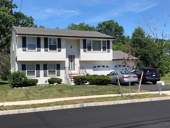 Wonderful split level home located next to shopping and major highways for commuting. Hurry won't last!!!!!