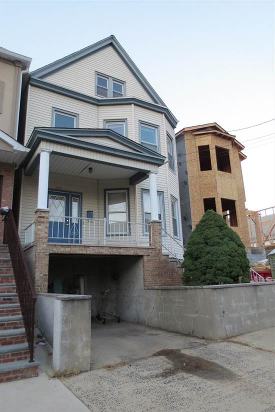 Picture yourself in the elegant & beautifully maintained three-story home in the heart of Hudson County. Just a quick 10 minute walk from the Harrison PATH train station. This 4 bedroom and 2.5 bath home comes complete with eat-in kitchen, separate dining room, open living room, attic, large fenced-in yard with deck, pool, brand new floors, and 1 car parking. Full unfinished basement with tons of potential, washer/dryer, and newer boiler can be found downstairs. What really makes this home unique is its authentic glass stained windows and charming mahogany wood doors and trimmings.