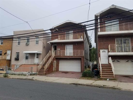 THIS IS AN AUCTION PROPERTY. 2 Family home in North Bergen with backyard, patio and 4 car attached garage plus 2 car driveway. Each unit has 3 Bedrooms, 2 full baths with master bedroom suite. Close to transportation, shopping and schools. BUYER RESPONSIBLE FOR ALL INSPECTIONS.