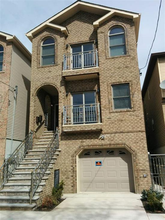 Must see this gorgeous 2 family new construction is a very quiet area in Jersey City. First level features a garage with plenty of storage space and a recreation room with a half bath. 1st floor features 3 bedrooms 2 full baths. Hardwood floors throughout the house, central air/heat. Kitchens on both levels features granite and stainless steel appliances. Washer/dryer in both units!