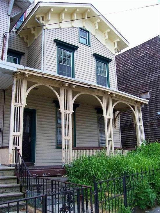 This great mid-19th Century Victorian house has good details, marble fireplaces, wide board flrs, early newel post, staircase with ribbon molding, original clg medallions, original door/window frames, basebds, and crown mouldings. It is a handyman AS IS sale . ready for a new Owner to finish the interior, add new bathrooms and new kitchen...finish the electrical work and add a new heating system..There are some new roofs, siding and windows. This house can, possibly, be converted to a 2 or 3 family.