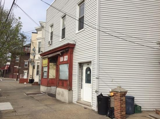 Great investment mixed use property. Studio, two one bedrooms plus commercial spot. Sold as-is. Fixer upper.