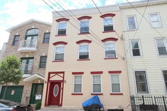 This solid, brick, 3 unit building is on a full sized 25X100 lot, located just around the corner from the 100 steps connecting Hoboken and Jersey City Heights. Each apartment has 2 bedrooms, washer/dryer, dishwasher, and open kitchen layouts which really make the 1100 sq ft homes feel even more spacious. Apartment #1 has private backyard. The separate utilities are located in the full unfinished basement. Laundry in every unit.