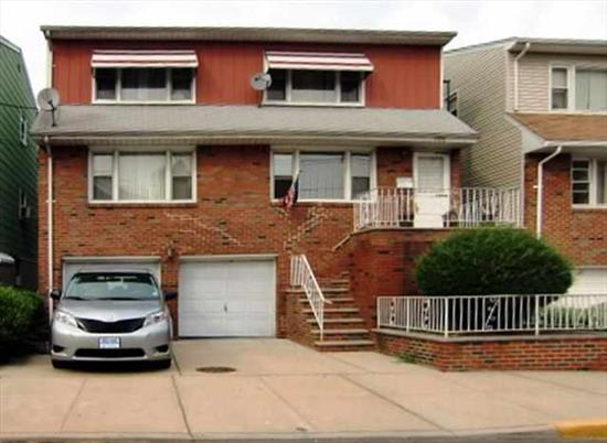 West New York Beautiful three family hardwood floors throughout large rooms, full finished basement great backyard great location very convenient to schools, shopping and public transportation.