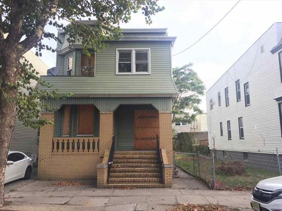 Divisible lot, once city permission obtained by buyer. New two family homes are selling for $560, 000 and higher in the immediate area. Nice block near NJ-440 shopping. Hot investment area. Existing vacant home has some limited fire damage on the first floor. Bring your best offers!