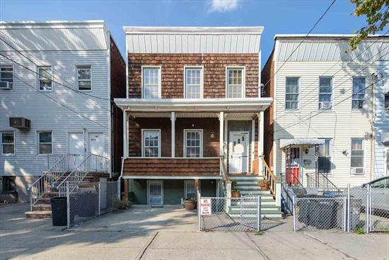 Charming Victorian home in the heart of Jersey City Heights! This one of a kind home offers a spacious living/dining room, large eat-in-kitchen, 3 bedrooms + den and 2 full bathrooms. Garden level features a massive family room, summer kitchen, full bathroom and direct access to a patio and beautifully landscaped private yard. 1 car parking and covered front porch add to this spectacular home. Located just 1 block away from Washington Park w/dog run, tennis courts, playground & picnic area! Also located moments from Hoboken, the bus line into Manhattan and Hudson/Bergen Lightrail.