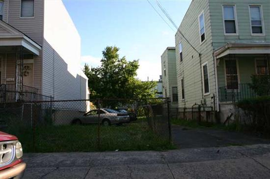 25X100 FULL BUILDING LOT. ZONED FOR 2 FAMILY HOME. CALL TODAY
