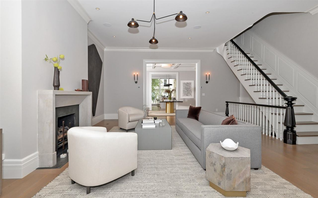 This outstanding 21.92' wide brownstone has been meticulously planned by professional design team J. PATRYCE DESIGN. Ideally located on a prime, tree-lined Hoboken block close to transportation, no expense was spared or detail overlooked during the restoration/expansion. Situated on a 21.92' x 100' lot, this bright, spacious home includes: 5 bedrooms, 4.5 baths, radiant heating through out, gourmet Sub-Zero/Wolf appliances, custom kitchen cabinetry/ladder system, Luce de Luna quartzite counters/backsplash, Marvin windows throughout, floor to ceiling exterior sliding glass wall, modern steel & cable exterior staircase, large private backyard with built in grill/refrigerator, fire pit, and IPE fencing. Other features include: Control4 smart home system, multi-zoned high velocity AC, natural gas generator, two limestone gas fireplaces, coffered dining room/library, custom millwork throughout, DR wet bar/sub zero wine refrigeration, white rift oak flooring throughout, spacious master suite with his and her walk-ins, Travertine marble bath, four large sky lights, 2 laundry rooms, a french drain system, built in speakers, security/alarm system, custom interior doors throughout, landscaping front and back, and much much more. Surely a home not to be missed and built for the most discerning buyer in mind.