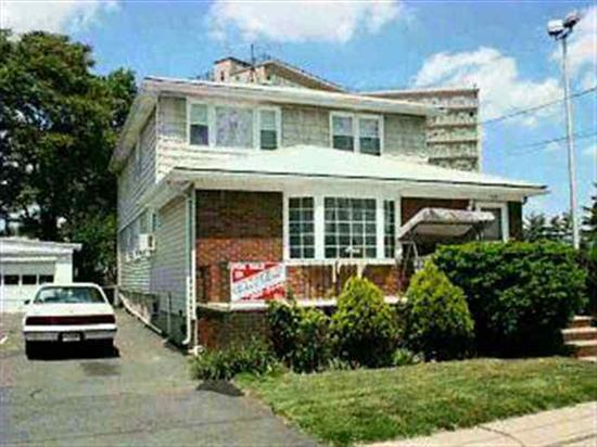 LOVELY HOME CLOSE TO SCHOOLS AND SHOPPING HD FLOORS. UP AND DOWN NEW WINDOWS. ROOF 3 YRS OLD. LOT 40 X 183. OWNER RENTS PARKING SPACES IN REAR MUST BE SEEN MOVE IN COND. WILL SHOW ONLY IST FL AND BASEMENT IF INT. BUYER WILL SHOW 2ND FL. NEEDS APP. PARKING FOR 7 CARS WITH DECK.