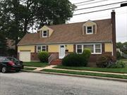 Wide line Cape with attached garage, North of Hempstead Turnpike. House has 4 Bedrooms and 2 Full Baths with an updated kitchen and partially finished basement. Newer Roof, Gas Hot Water Heater &Gas Heating Unit. Walking distance to Washington St. elementary and Carey high school.