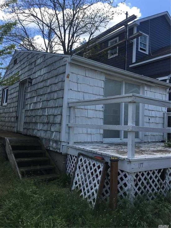 Being SOLD AS IS (Hurricane Sandy damaged property)  8 Houses from Ocean Sand & Sugar Bowl! Approx 100' from 8th Ave Parking Lot. Close to stores. New Construction may be rebuilt-1st Floor= 17'x55'; 2nd Floor= 17'x49'; Please See attached Survey & Breezy Point Purchasing Procedures; GREAT LOCATION!!