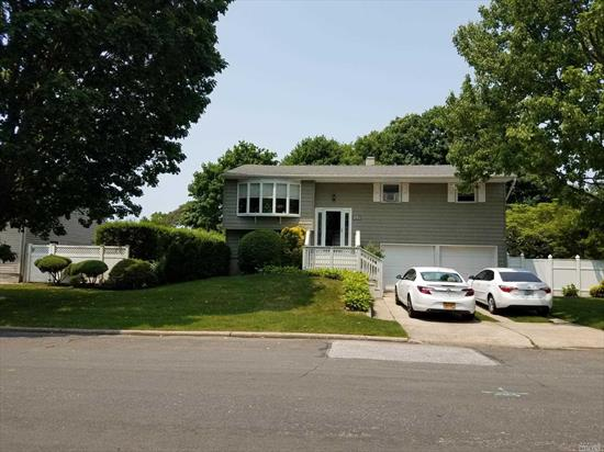 Immaculate Hi Ranch Features: gleaming hardwood floors, SS & Granite Kitchen, 4 BR, 2 BA, LR, DR, Family Room with OSE and Room for Mom. Stone patio, manicured yard & 2 car garage.