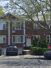 Large and Specious 2 family brick dwelling. 2 Bedrooms 1 bath, over 2 Bedrooms 1 bath, lving room, eat in kitchens, garage, driveway and private back yard. Steps to shopping, transportation, houses of worship, Queens College.
