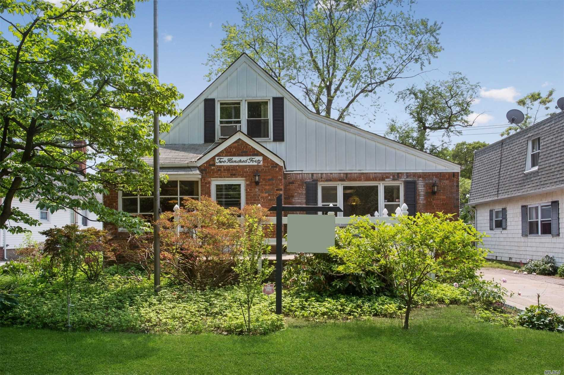Spacious Cape In The Village Of Floral Park. If You Want The Feeling Like Your Living In The Country, Sit on the Front Porch, Relax and Enjoy This Lovely Home With Views Of Beautiful Centennial Gardens. Home Features: Living Rm; Dining Rm;Eat-in-Kitchen; First Floor Master Bedroom;Full Bathroom; Second Bedroom or Den; Second Floor Has Two Additional Bedrooms; Full Basement; 1 1/2 Car Garage & Yard. FPBS #22.
