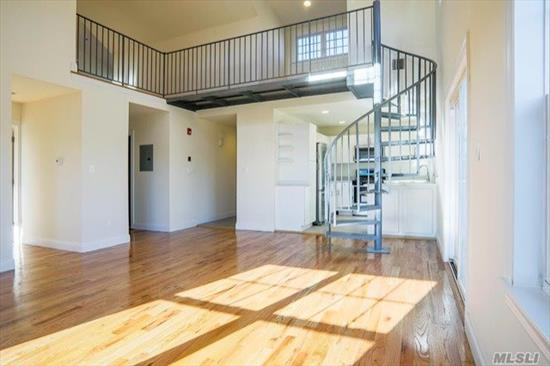 Newly Constructed And Customized Loft Apartments With Lots Of Natural Light. Located Within 2 blocks of the LIRR train station restaurants and shops. Gourmet kitchen with stainless steel appliances and quartz counter tops. Elegantly appointed bathrooms, Natural wide plank oak flooring throughout apartment. Soaring 2 story living room with ceiling fan and spiral staircase leading to den or personal work space. Individual clothes washer and dryer. Central a/c and heating. Video/audio intercom