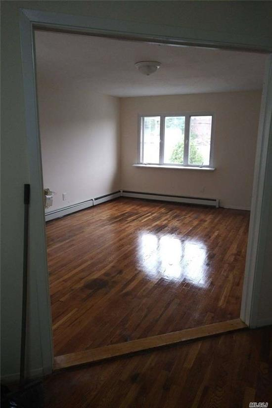 Renovated 2nd Floor 3 bed room Apt gleaming Hardwood floors large closets